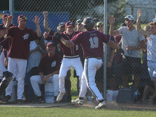 Menomonee Falls players and fans are all smiles as