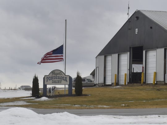 The American flag is at half-staff, Feb. 23, 2018, at Pagel's Ponderosa Dairy in Kewaunee County. CEO John Pagel and his son-in-law Steve Witcpalek were among three people killed a day earlier when a Green Bay-bound plane crashed in Indiana.