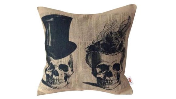 The burlap material gives these spooky pillow cases a rustic vibe.
