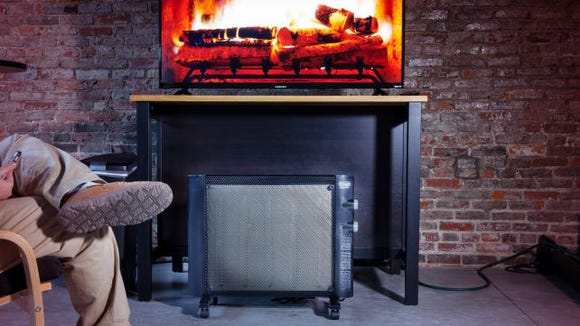 Don't turn the heat on yet. Use this space heater instead.