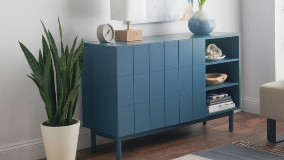 The slate blue MoDRN Link Double Door cabinet can organize a room by storing your stuff.