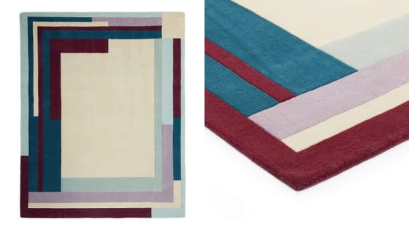 This wool rug adds color and softness to a room.