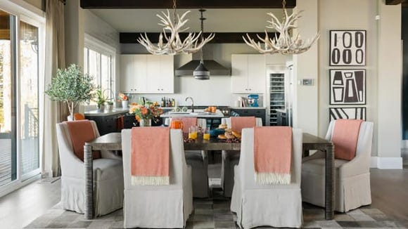 Entertain in style with a table full of food and some comfy chairs.