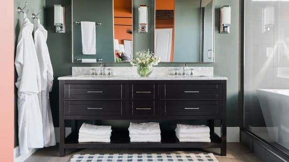 The calming colors create a relaxing vibe in the master bathroom.