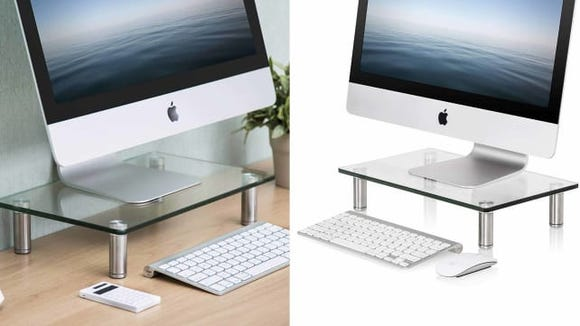 For a minimalist look, this glass monitor stand is perfect.
