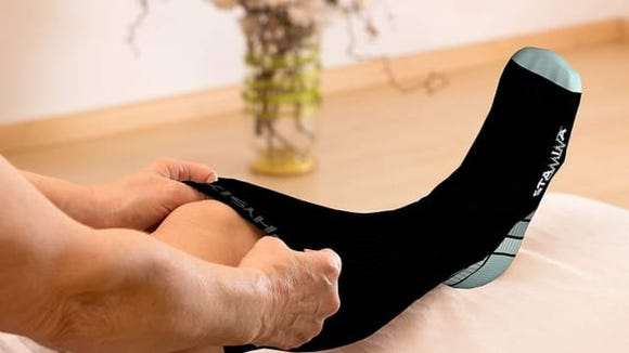 These compression socks can increase circulation when you sit through long hours of flying.