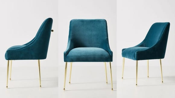 With its plush velvet upholstery, this chair is so inviting.