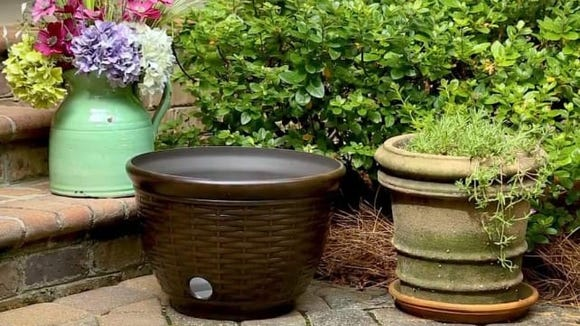 This bronze hose pot is a better way to organize your garden hose.