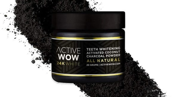This charcoal powder will turn your mouth black—but get your teeth white!
