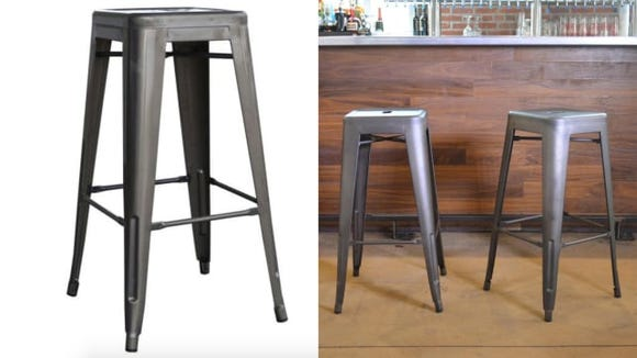 This set of four industrial bar stools is the perfect way to add some edge to your decor style.