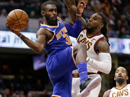 New York Knicks' Tim Hardaway Jr., left, passes around Cleveland Cavaliers' Jae Crowder in the second half of an NBA basketball game, Sunday, Oct. 29, 2017, in Cleveland. The Knicks won 114-95. (AP Photo/Tony Dejak)