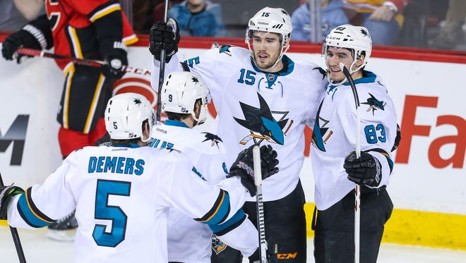 San Jose Sharks left wing James Sheppard celebrates his goal with teammates against the Calgary Flames during the first period at Scotiabank Saddledome.