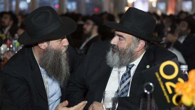 Rabbi Zvi Konikov, of Chabad of the Space & Treasure Coasts in Satellite Beach, shares a moment on Sunday with a colleague at a banquet in New York City. He was among over 5,000 rabbis and guests attending the annual International Conference of Chabad-Lubavitch Emissaries.