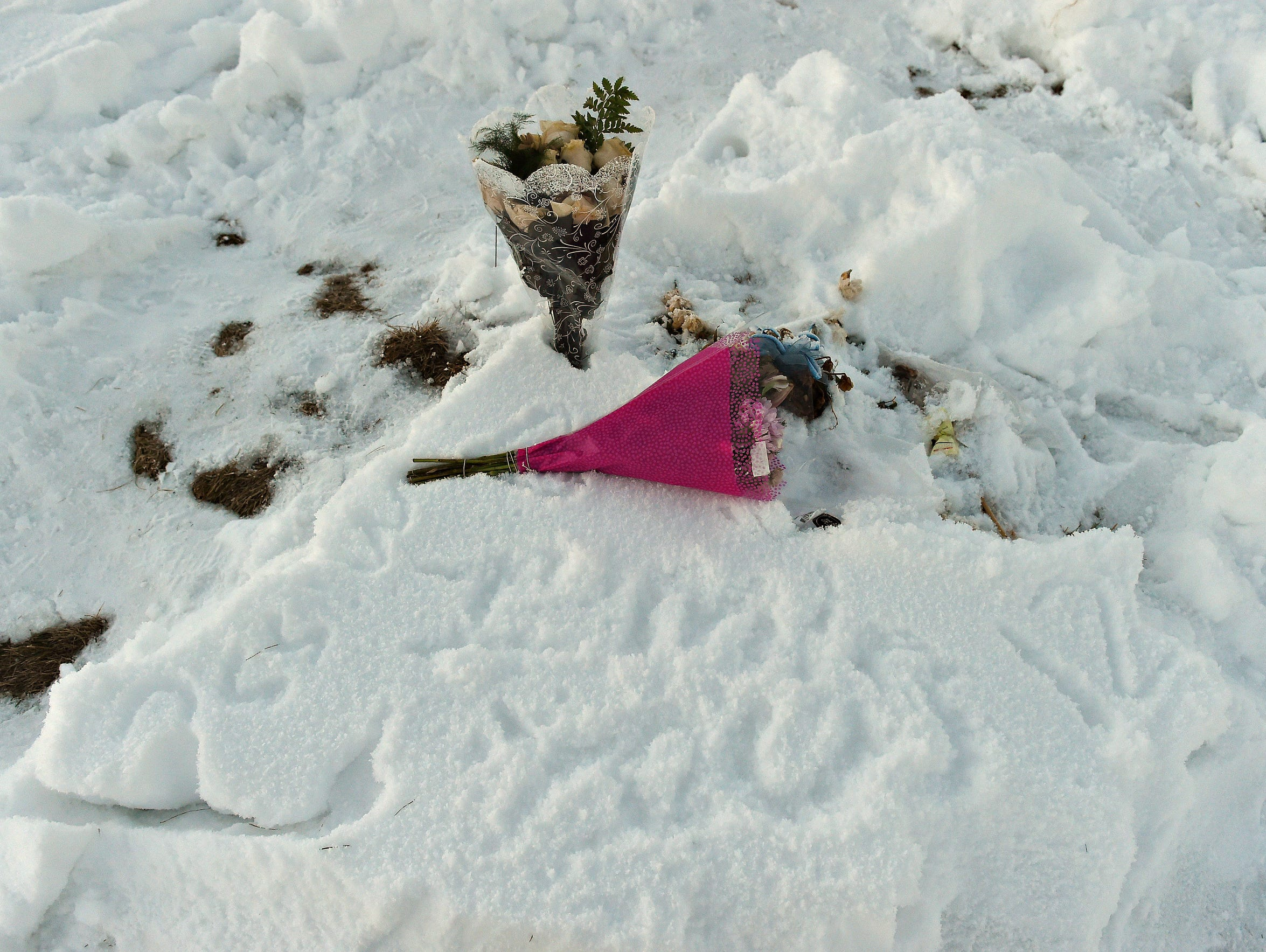 A small yellow flag and flowers mark Ariana Cordova's