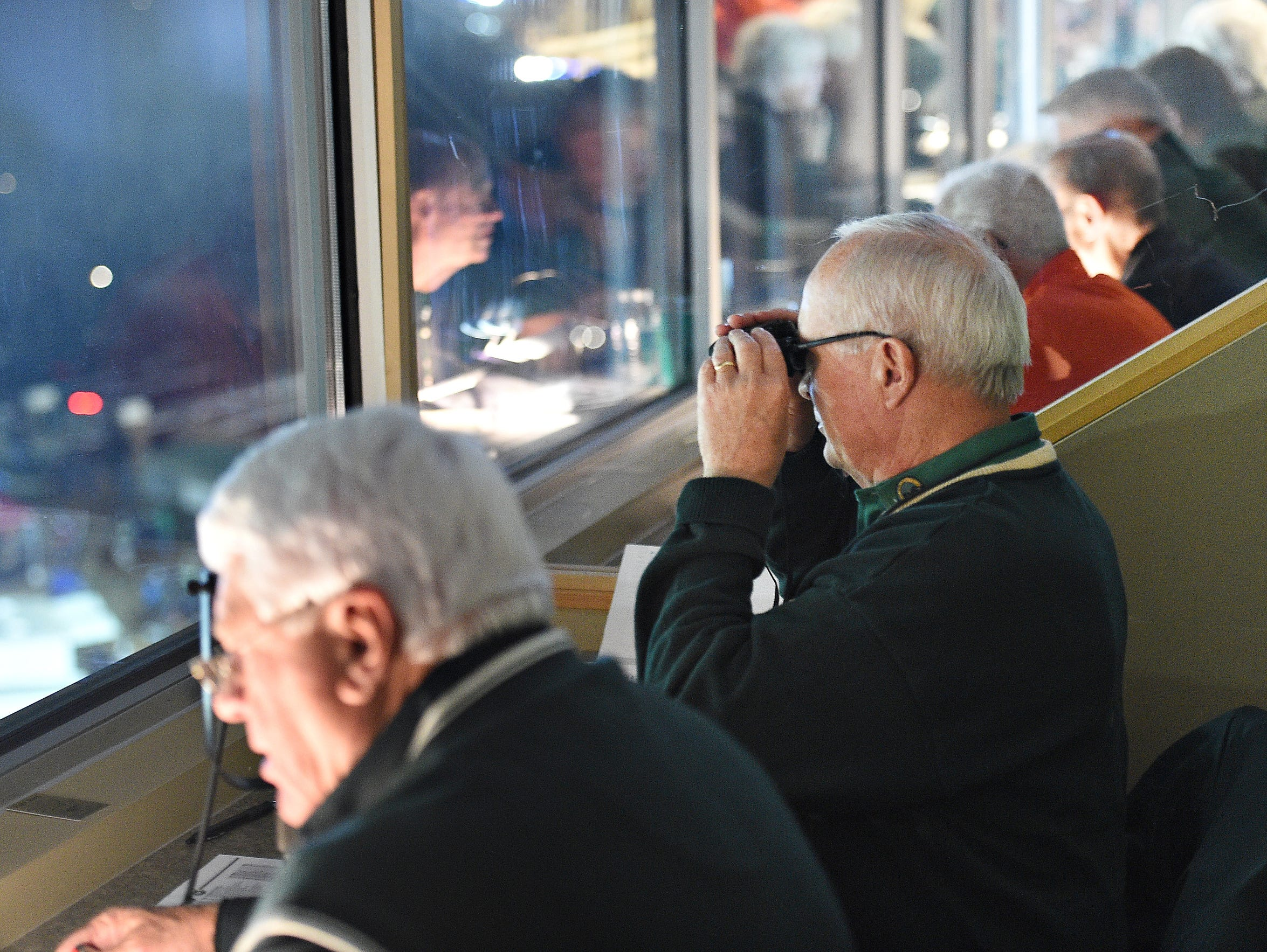 Donn Hopkins volunteers in the CSU press box at Hughes