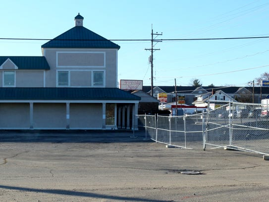 Fencing is up and demolition is underway at the former