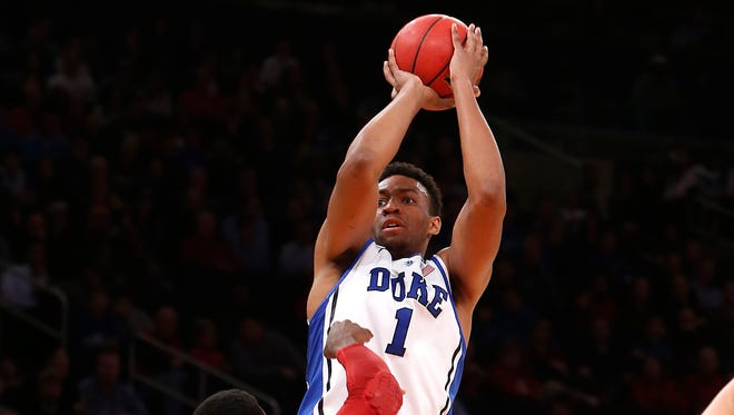 Duke's Jabari Parker (1) shoots against Alabama's Rodney Cooper (21) during the first half of an NCAA college basketball game in the semifinals of the NIT Season Tip-off tournament Wednesday, Nov. 27, 2013, in New York.