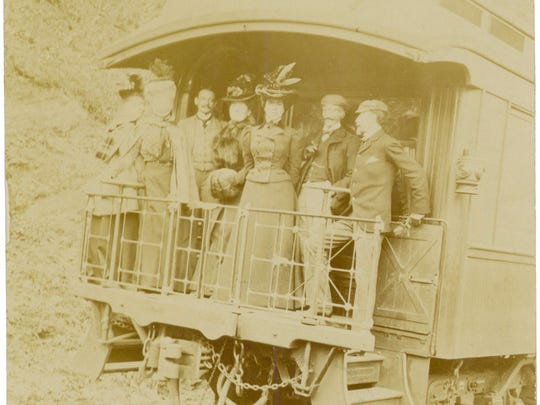 Passengers gather on the back of the Swannanoa, George Vanderbilt's private railway car, which carried guests from D.C. and New York to Asheville and back.