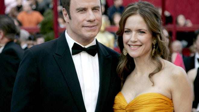 Kelly Preston, right, arrives with husband John Travolta for 2008 Academy Awards. Travolta announced Sunday night that Preston, 57, died after a two-year battle with breast cancer.