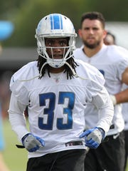 Detroit Lions safety Alex Carter walks off the field