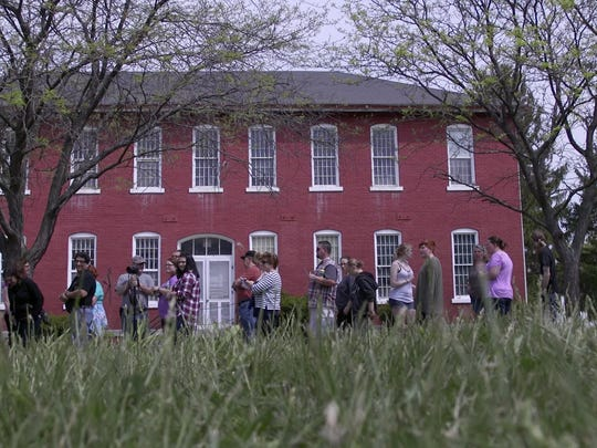People attending the Willard Asylum Tour wait in a long line to see the morgue. Organizers were overwhelmed by the number who showed up for the 9 a.m. tour.