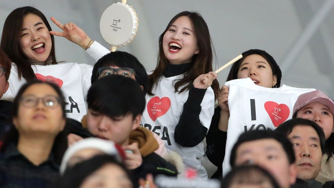 Korean fans sing and dance in between heats of a 10,000-meter speedskating event during the Pyeongchang 2018 Olympic Winter Games at Gangneung Ice Arena.