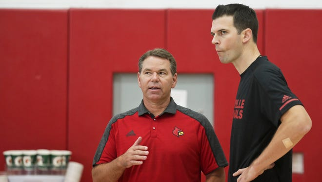 "Louisville acting men's basketball coach David Padgett, right, talks with acting athletic director Vince Tyra during a practice Wednesday afternoon at the YUM! practice facility. ""I don't think we could've made a better interim (AD) hire than Vince (Tyra),"" said Padgett at a press conference earlier. ""He and I are both in tough positions."""