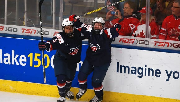 Brianna Decker (left) and Kendall Coyne celebrate the