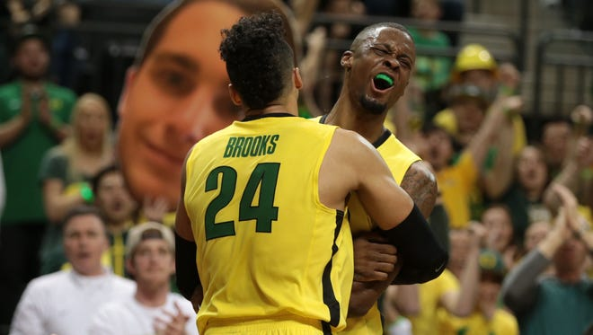 Feb 28, 2016; Eugene, OR, USA; Oregon Ducks forward Dillon Brooks (24) and forward Elgin Cook (23) celebrate at the end of the game against the Washington Huskies at Matthew Knight Arena. Mandatory Credit: Scott Olmos-USA TODAY Sports