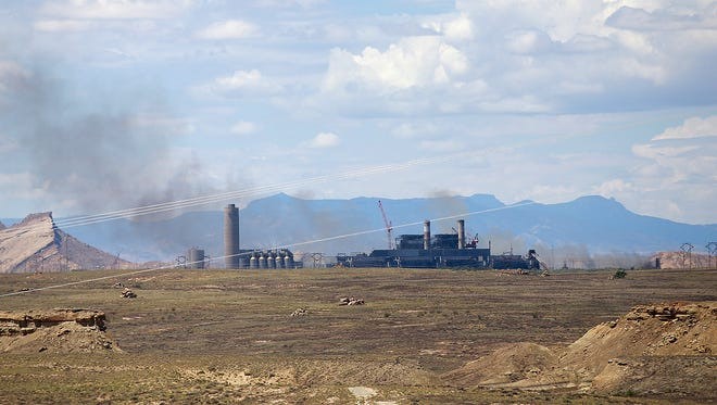 Smoke can be seen on Thursday at the Four Corners Power Plant in Fruitland after a fire broke out.
