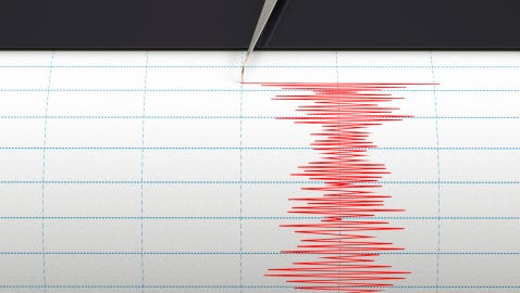 Seismograph instrument recording ground motion during earthquake.