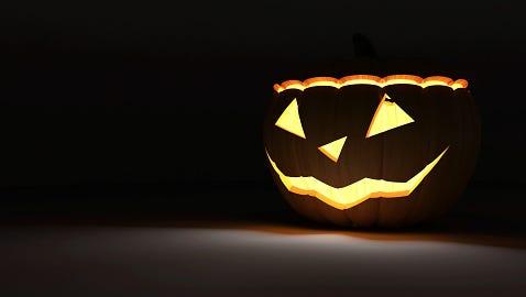 Halloween Jack O Lantern Pumpkin on dark background