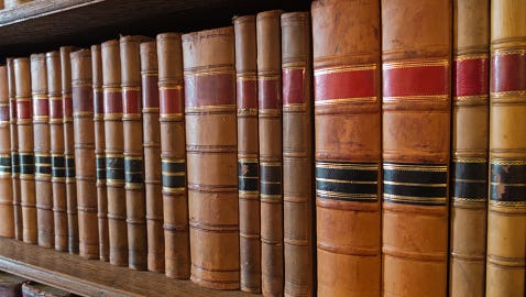Old library books on a shelf.