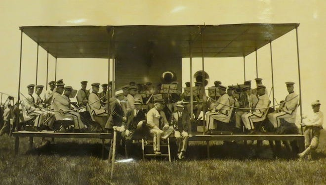Herman Dossenbach and the Rochester Park Band perform on Aviation Day, June 1, 1928. They are on a portable bandstand designed and patented by Hermann's brother Theodore Dossenbach.