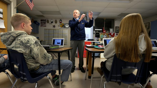 "Freedom High School teacher Paul Larson explains water quality readings to students in Freedom. Larson received a ""VIP citation"" from the National Future Farmers of America."