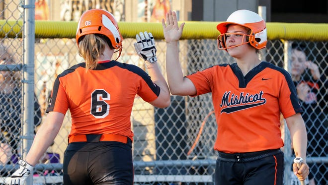 Mishicot's Kourtney Leroy (6) high fives Katie Koeppel (14) as she steps up to bat Tuesday, May. 16, 2017, in Mishicot, Wis. Josh Clark/USA TODAY NETWORK-Wisconsin