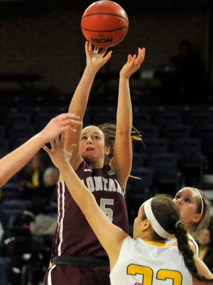Former Lewistown-Fergus standout McCalle Feller (5), playing for the University of Montana in this undated file photo, shoots over Northern Colorado's Kianna Williams.