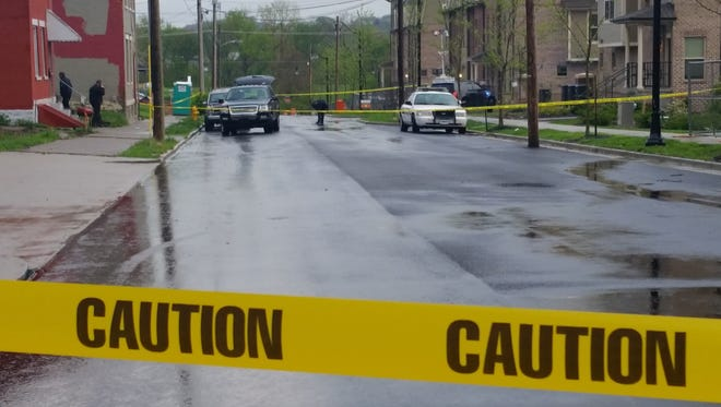 Covington police cordoned off an area on East Robbins street where Daleon Rice, accused of stabbing a woman and shooting a police K-9 was taken into custody after a manhunt.