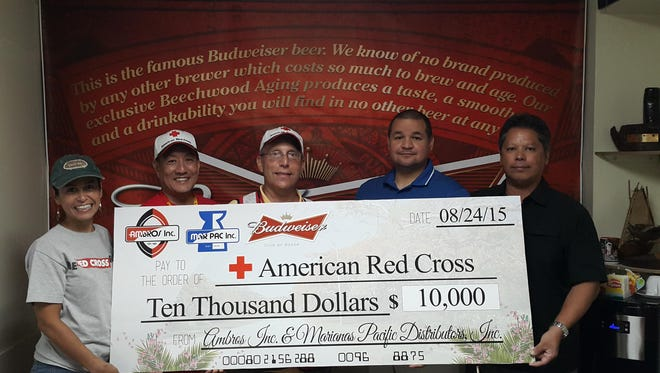 "In an effort to assist those affected by Typhoon Soudelor, Marpac Inc. and Ambros Inc. (Guam) donated $10,000 to the American Red Cross. Ambros Inc. General Manager Tom Shimizu stated, ""Our friends, family and neighbors in the CNMI need our help. As a family-owned company rooted deep within the community, we had to act. These donated funds will be used to provide urgently needed supplies."" From left are: Tayna Belyeu-Camacho, Chairperson, ARC; Rick Lee, Vice Chair, ARC; John Hirsh, Executive Director, ARC; Guy Pudney, Resident Manager, Marpac; and Paul Camacho, Emergency Services Director, ARC."