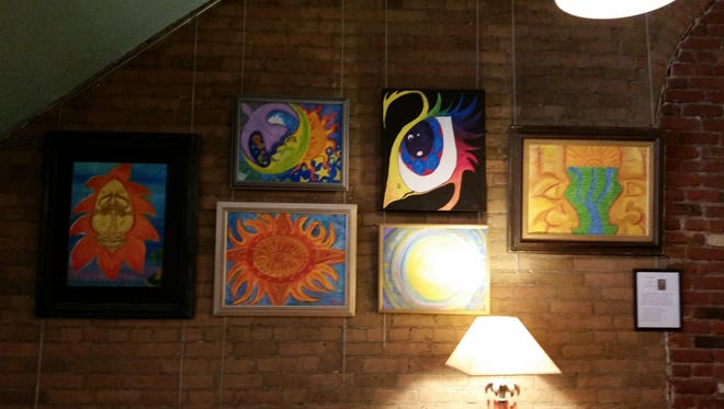 A selection of Joy Staelens' nature pieces make an appearance at Electric City Coffee during the First Friday Art Walk.