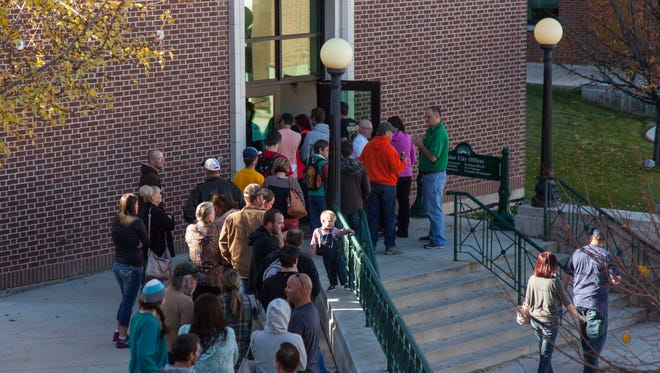 Cedar City residents wait to vote in a line outside the Cedar City City Offices on Election Day, Tuesday, Nov. 8, 2016.
