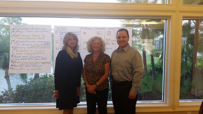 Gigi Suntum, 4Cs executive director, Roseann Ryba, United Way Executive Service Corp,, and Tony Losh, 4Cs board president