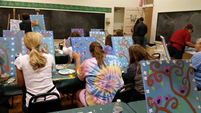 """Local residents participate in a """"Canvas and Cabernet"""" event held by the Yerington Chamber of Commerce and Yerington Theater for the Arts in August 2016 at the Jeanne Dini Center."""