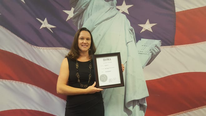 """Stephanie Nelson with the FPRA Judges' Award for """"Pop In To Register"""""""