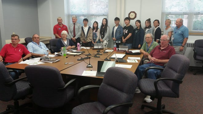 Eight Chinese college students visit the county's Administrative Committee meeting on Tuesday. Six of the students are from Door County's Sister City of Jingdezhen, while the other two are also working at Door County restaurants and retailers this summer. County officials pictured, seated from left, are Supervisors Richard Virlee, John Neinas, Kathy Schultz, Ken Fisher and Dan Austad. Standing and flanking the students are Supervisor Joel Gunnlaugsson, County Corporation Counsel Grant Thomas, County Land Use Services Director Mariah Goode and County Board Chairman David Lienau.