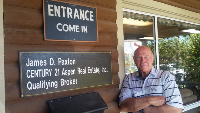 James Paxton stands outside his Century 21 Aspen Real Estate office in Ruidoso.
