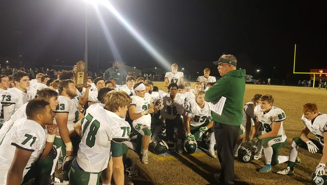 Trinity coach bob Beatty speaks with his team after Friday's big win in the psotseason over Central Hardin. Nov. 24, 2017