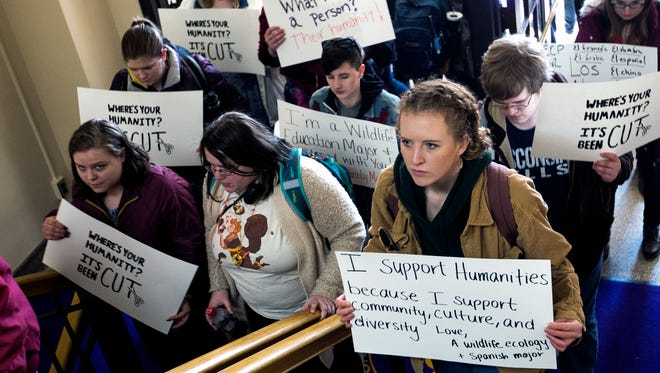 Protesters enter Old Main, the university's administration building, for a sit-in to protest a proposal to cut 13 liberal arts majors at the University of Wisconsin-Stevens Point in Stevens Point, Wis., Wednesday, March 21, 2018.