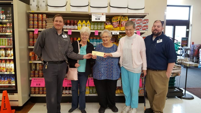Harps Foods Store of Bull Shoals recently presented $4,000 in gift cards to the Bull Shoals Food Pantry for the purchase of groceries. Pictured are: (from left)Jacob Moss, Harps Store Manager;Peni Lloyd, Treasurer of Bull Shoals Food Pantry;Bonnie Galvan, Manager, Bull Shoals Food Pantry;Sharon Aara, Inventory Manager, Bull Shoals Food Pantry; and Josh Gunter, Harp's Grocery Manager.