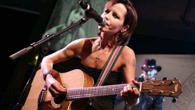 In this 2008 file photo, The Cranberries lead singer Dolores O'Riordan performs during the European Border Breaker Awards in Cannes, France. O'Riordan has died at age 46.